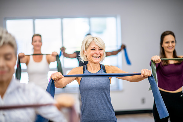 Woman in gym class with resistance band